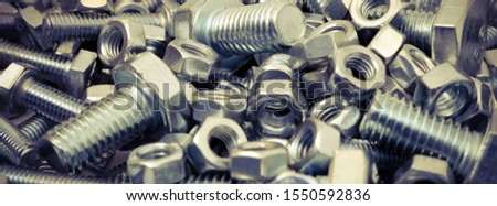 Abstract industrial background. Bolts and nuts. Many metalware. #1550592836