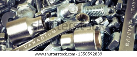 Abstract industrial background. Bolts and nuts. Many metalware. #1550592839