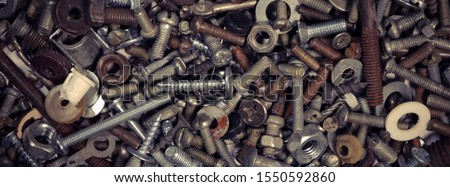 Abstract industrial background. Bolts and nuts. Many metalware. #1550592860