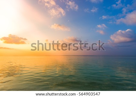 Abstract inspirational sunset photography for background, sky and clouds with sea