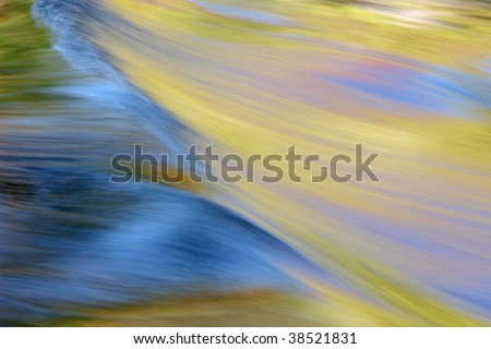 Abstract landscape of rapids on the Ontonagon River illuminated by reflected color from sunlit autumn trees, Michigan's Upper Peninsula, USA