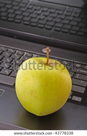 Abstract laptop with green apple