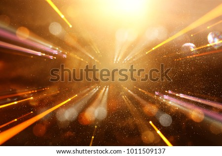 Abstract lens flare. concept image of space or time travel background over dark colors and bright lights #1011509137