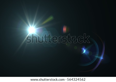 Abstract lens flare light over black background - Shutterstock ID 564324562