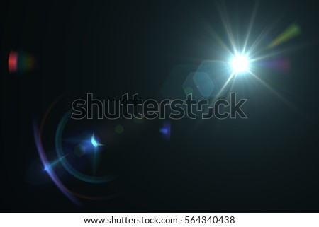 Abstract lens flare light over black background - Shutterstock ID 564340438