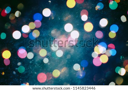 Abstract light celebration background with defocused golden lights for Christmas, New Year, Holiday, party