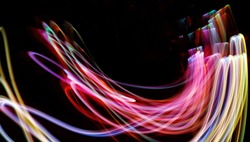 abstract light painting colorful letter Freeform long exposureshot on black background