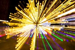 Abstract lightburst camera zoom movement yellow green purple lights