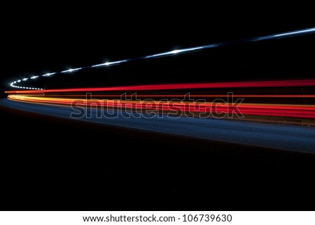 Abstract lights from an ambulance in a road tunnel