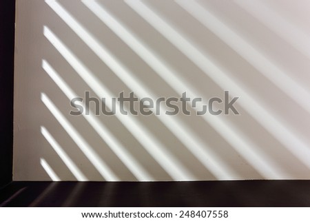 Abstract line pattern from light and shadows on wall