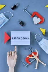 abstract lockdown symbols are laid around the captain 'LOCKDOWN' such as locks lose screws, a heart in a clamp and a figure in a clamp