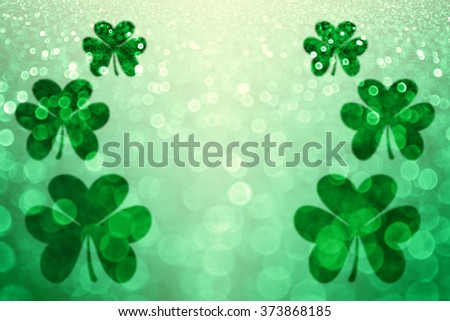 Abstract lucky green Irish St Patrick's Day Shamrock glitter sparkle background or party invite
