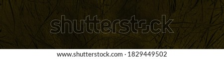 Photo of  abstract macabre black and dark yellow colors background for design.