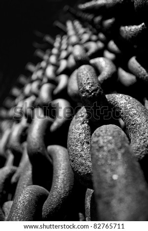 Abstract macro of an iron chain curtain in black and white