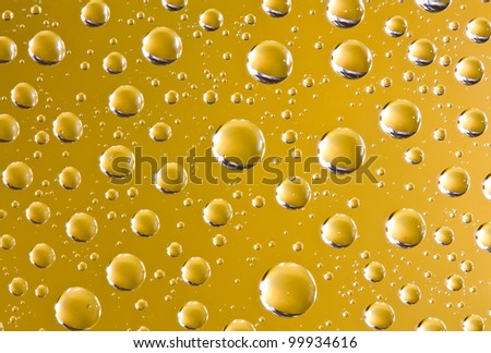Abstract macro of water drops over golden background