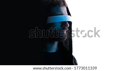 Photo of Abstract man portrait in VR helmet. Digital art. Male in glasses of virtual reality. Augmented reality, dream, future technology, game concept. Blue neon light. White background. Free space for text.