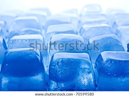 Abstract melted ice cubes blue toned. Horizontal. Closeup. - stock photo
