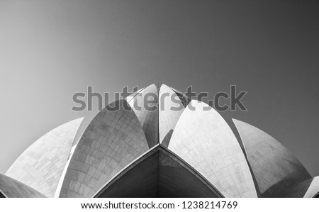 Abstract Minimal Architecture of the Bahai House of Worship or the Lotus Temple, India with view of the top lotus petals made of white tiles