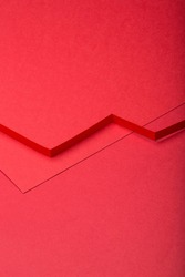 Abstract minimal paper background. Red cut out zig zag paper stripe on red background.