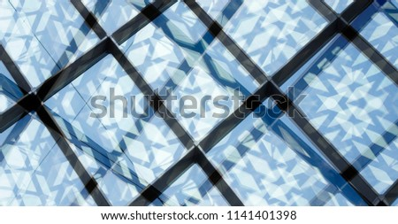 Abstract modern architecture background with geometric structure. Glass wall of office building visible through another glass wall. Grid structures of different scale. Structural glazing.  #1141401398