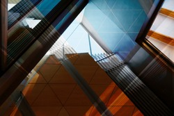 Abstract modern architecture background with reflections and shadows. Reworked photo of office interior fragment with geometric structure featuring louvers and dropped ceiling.