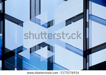 Abstract modern architecture. Double exposure photo of glass wall with metal framework. Structural glazing. Fragment of office building with clear blue sky.  #1173576916