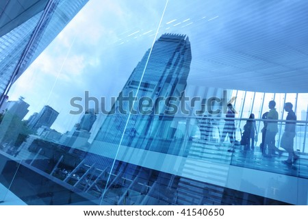 Abstract modern city background with people walking over buildings reflections. #41540650