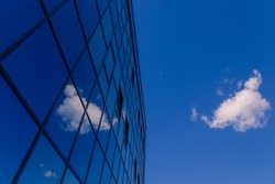 Abstract modern office building. Reflections of the sky in the glass surface.