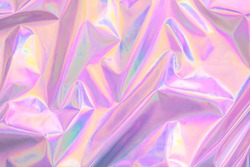 Abstract Modern pastel colored pink holographic background in 80s style. Crumpled iridescent foil textile real texture. Synthwave. Vaporwave style. Retrowave, retro futurism, webpunk