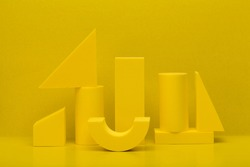 Abstract monochromatic composition with yellow geometric figures against yellow background