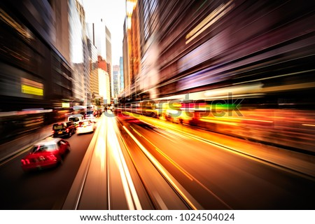 Abstract motion blur image of Hong Kong city street FOV from moving tram #1024504024