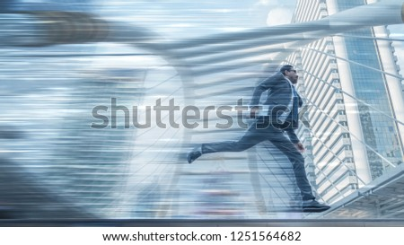 abstract motion blurred background of motion blurred businessman with tablet on hand runing with speed motion trails and background of skyscrapers in city in conpept of running business at high speed #1251564682