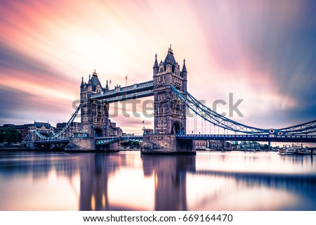 abstract moving clouds during sunrise London Tower Bridge, Sunrise with reflection in the water Thames river London Tower Bridge  #669164470