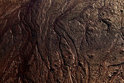 Abstract mud background with water washout trails and selective focus. Mars terraforming background.