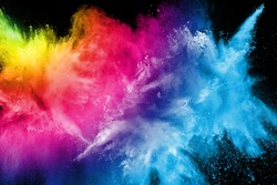 Abstract multi color powder explosion on black background.  Freeze motion of color dust  particles splash. Painted Holi in festival.