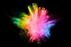 Abstract multi colored powder explosion on white background.. Closeup of  colorful dust particles splattered isolated on white  background.