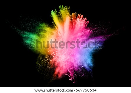 Abstract multi colored powder explosion on white background.. Closeup of  colorful dust particles splattered isolated on white  background. #669750634