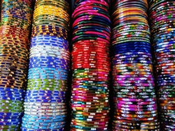 Abstract Multicolor Colorful Indian Bangles at the market of Dubai, United Arab Emirates. Abstract background of Red, Purple, Yellow, Blue, Green, Grey, Orange, Pink and white color.