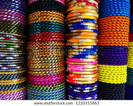 Abstract Multicolor Colorful Indian Bangles at the market of Dubai, United Arab Emirates. Abstract background of Red, Purple, Yellow, Blue, Green, Grey, Orange, Pink and white color.  - Shutterstock ID 1220315863