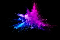 abstract multicolored powder splatted on black background,Freeze motion of color powder exploding