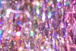 Abstract multicolored purple rainbow background. Defocused light streaks tinsel with bokeh effect.