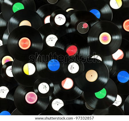 Abstract music colorful background made of vintage vinyl records, isolated over white background, all labels designed by myself