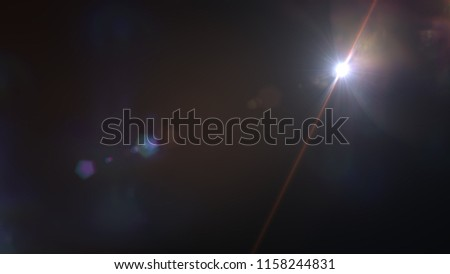 Abstract Natural lens flare ,Sun flare on the black background. #1158244831
