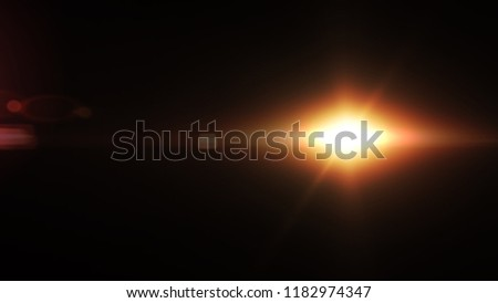 Abstract Natural lens flare with black background. #1182974347