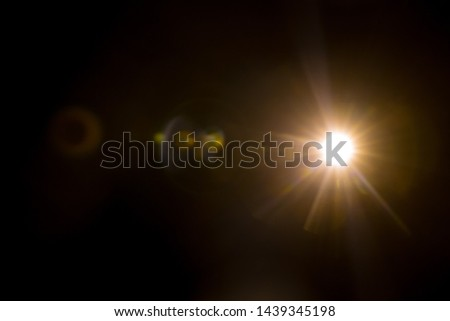Abstract Natural Sun flare on the black #1439345198