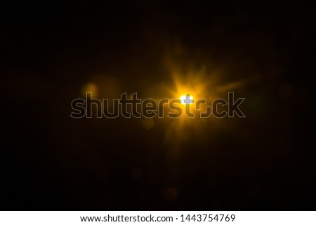 Abstract Natural Sun flare on the black #1443754769