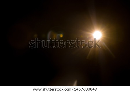 Abstract Natural Sun flare on the black #1457600849