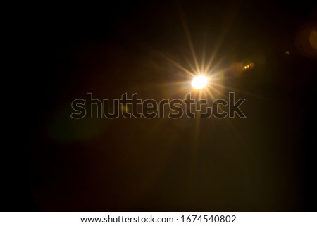 Abstract Natural Sun flare on the black Foto stock ©