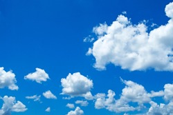 Abstract nature background of Beautiful sunny blue sky with white puffy & fluffy cumulus cloud & cloudscape in tropical summer or spring bright sunlight on horizon skyline at sunshine day, copy space