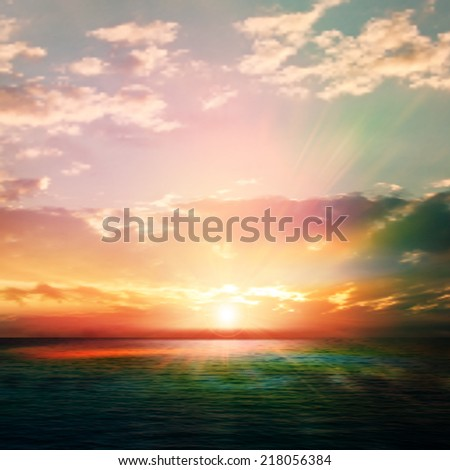 abstract nature background with sunrise and green ocean #218056384